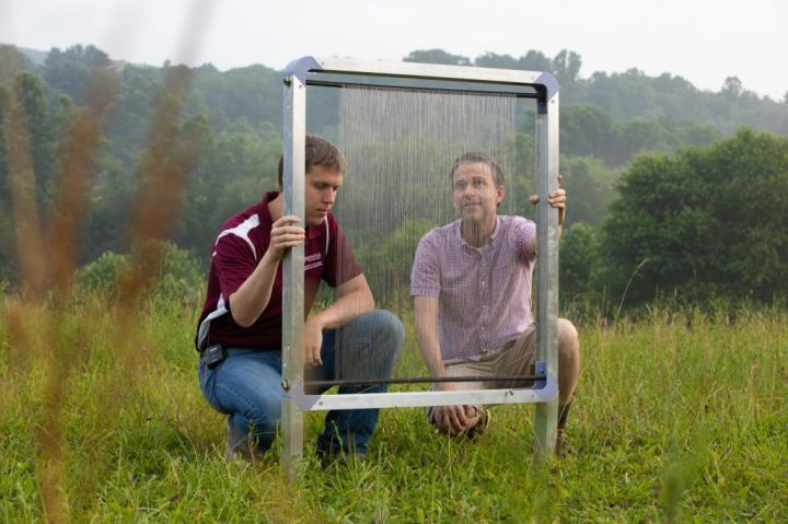 Jonathan Boreyko and Brook Kennedy inspect a fog harp at Kentland Farm. (Photo: Peter Means for Virginia Tech.)